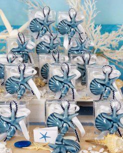 bomboniera calamita conchiglia e stella marina su scatolina trasparente con cordoncino