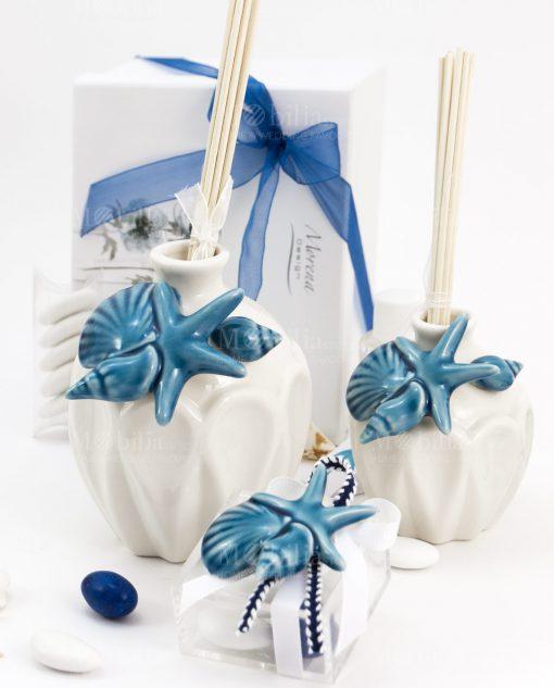 bomboniera profumatore grande e piccolo bianco porcellana con applicazione stella amrina e conchiglie con bastoncini e scatolina confezionata con magnete tema mare morena