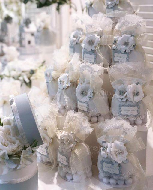 pochette portaaconfetti con rete sul fondo con fiori merletto e nastri linea sweet memori rdm design