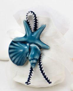 sacchetto confezionato bianco con nastro applicazione magnete tema mare blu