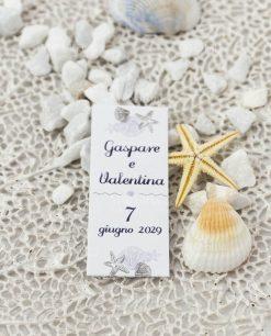 bigliettino cerimonia tema mare con conchiglie e stella marina