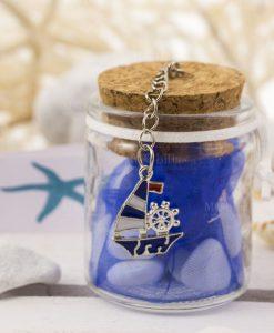 bomboniera barattolo vetro portaconfetti con ciondolo barchetta blu
