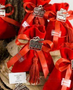 bomboniera sacchetto rosso velluto con napina e ciondolo ciak tabor