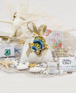 bomboniera solidale magnete tartaruga ceramica artigianale caltagirone con semi di fiori legambiente