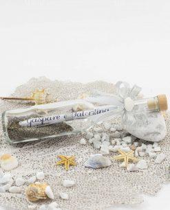 bottiglia portamessaggio con invito cerimonia e fiocco co conchiglia