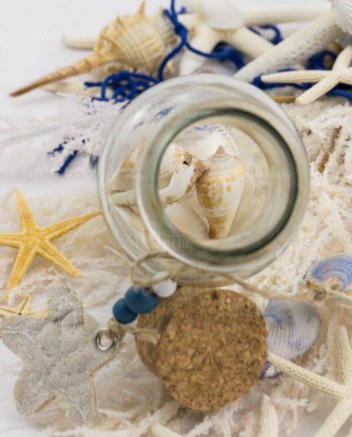 provetta vetro con conchiglie tappo sughero
