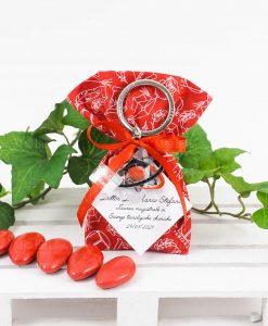sacchetto rosso con scritte bianche ciondolo portachiavi