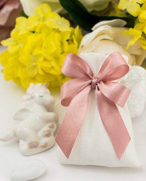 bomboniera magnete porcellana unicorno su sacchetto bianco con fiocco rosa