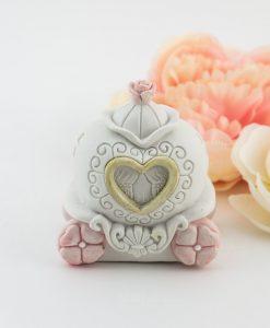 salvadanaio carrozza bimba con fiori rosa e cuore oro