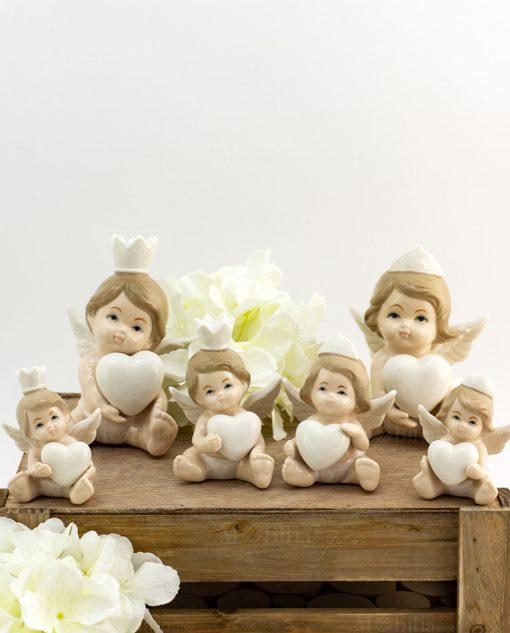 scultura angelo principe e principessa con cuore varie misure porcellana