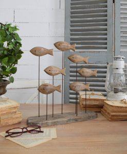 scultura legno con pesci orchidea milano