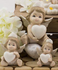 sculturina angioletto bimba con cuore e corona varie misure