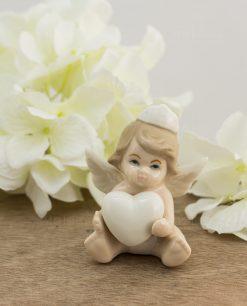 sculturina piccola angioletto bimba cuore e corona porcellana
