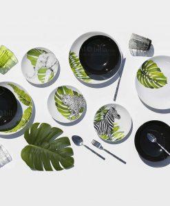 servizio piatti con stampa animali e foglie su sfondo bianco piatti fondi neri collezione safari villa deste