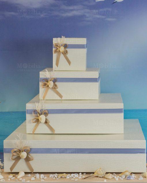 torta portabomboniere a piani con fiocchi conchiglie e stella marina