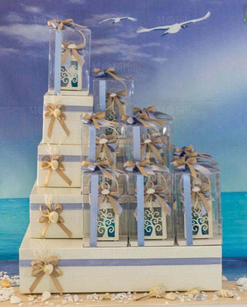 torta portabomboniere con natro avion stella marina e conchiglia bomboniera lanterna albero della vita
