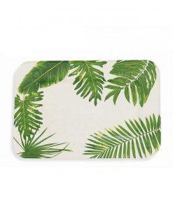 vassoio rettangolare con foglie verdi su sfondo bianco collezione jungle villa deste