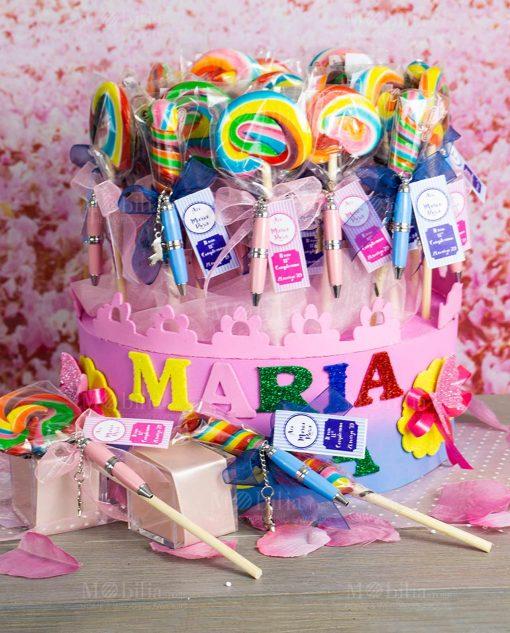 bomboniera penna piccola rosa e azzurra ciondolo bimbo e bimba su caramella lecca lecca su stecco
