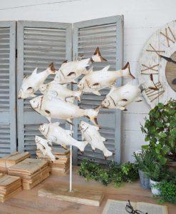 scultura branco di pesci bianchi metallo orchidea milano