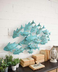 scultura da parete 3d branco pesci azzurro ferro effetto usurato orchidea milano