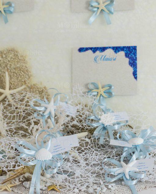 segnaposto gessetto bianco conchiglia stella timone con fiocchi azzurri e rete bianca